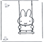 Little rabbit on swing